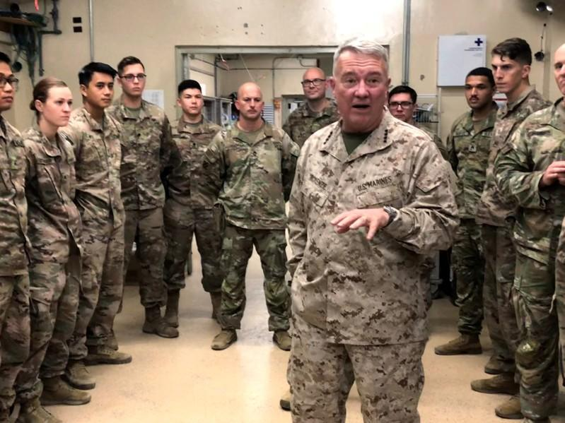FILE PHOTO: Marine General Kenneth McKenzie speaks with U.S. troops while visiting Forward Operating Base Fenty in Jalalabad, Afghanistan