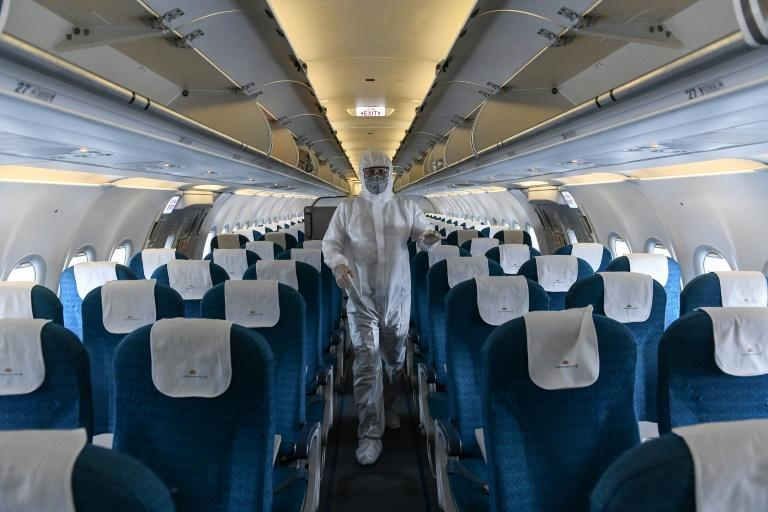 Thirteen passengers on a flight to Vietnam from Britain were found to be infected with the coronavirus