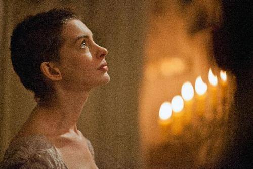 """This film image released by Universal Pictures shows actress Anne Hathaway portraying Fantine, a struggling, sickly mother forced into prostitution in 1800s Paris, in a scene from the screen adaptation of """"Les Miserables."""" Hathaway was nominated Thursday, Dec. 13, 2012 for a Golden Globe for best supporting actress for her role in """"Les Miserables."""" The 70th annual Golden Globe Awards will be held on Jan. 13. (AP Photo/Universal Pictures, Laurie Sparham)"""