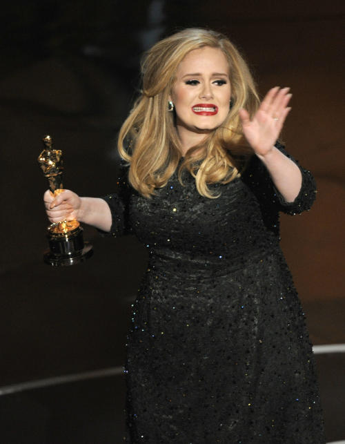"""Singer Adele accepts the award for best original song for """"Skyfall"""" from the film """"Skyfall"""" during the Oscars at the Dolby Theatre on Sunday Feb. 24, 2013, in Los Angeles. (Photo by Chris Pizzello/Invision/AP)"""