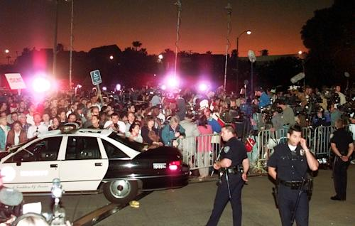 FILE - In this Feb. 4, 1997, file photo, A large crowd gathers outside Los Angeles County Superior Court in Santa Monica, Calif., to hear the verdict in the wrongful-death civil trial against O.J. Simpson. Simpson was found liable in the deaths of Nicole Brown Simpson and Ron Goldman. The return of O.J. Simpson to a Las Vegas courtroom next Monday, May, 13, will remind Americans of a tragedy that became a national obsession and in the process changed the country's attitude toward the justice system, the media and celebrity. (AP Photo/Mark J. Terrill, File)