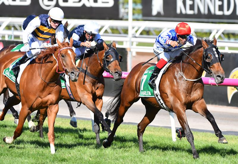 A photo of Michael Walker riding Harlem wins Race 8, TAB Australian Cup during Melbourne Racing at Flemington Racecourse on March 10, 2018 in Melbourne, Australia.