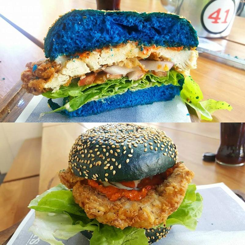 The epic eat consists of triple chilli, fried chicken and blue cheese sandwiched in an electric blue bun. Source: Supplied.