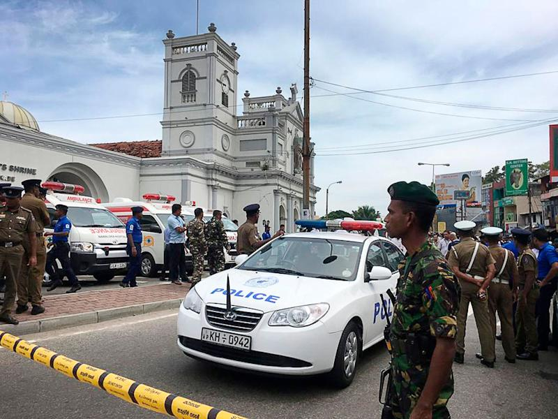Sri Lankan Army soldiers secure the area around a church after a blast in Colombo, Sri Lanka, on Sunday. Witnesses are reporting explosions hit three churches in Sri Lanka on Easter Sunday, causing casualties among worshippers. Source: AAP