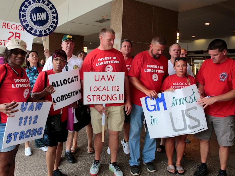 Auto workers from the General Motors Lordstown assembly plant stop to be photographed while protesting GM plant closings outside General Motors World Headquarters in Detroit, Michigan, U.S. July 16, 2019. REUTERS/Rebecca Cook