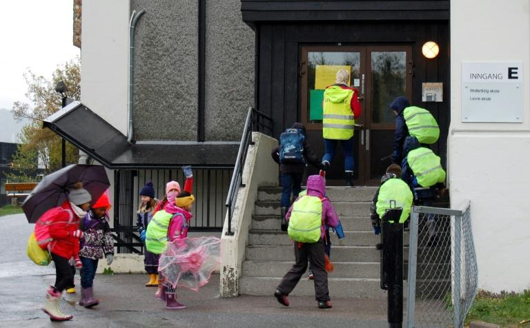 Pupils enter Levre school in Baerum, west of Oslo, as the school reopens for younger pupils after a six-week shutdown due to the new coronavirus pandemic. Norway says it has the new coronavirus epidemic under control but some parents are worried