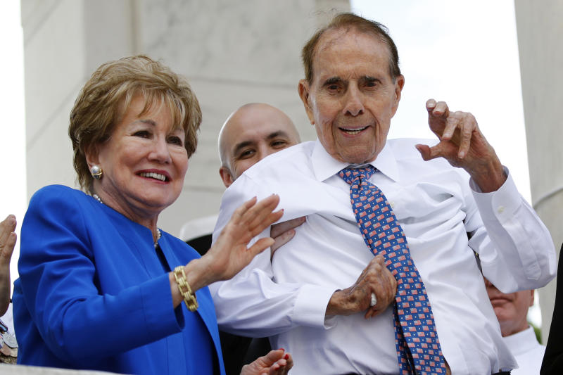 "FILE - In this May 27, 2019 file photo, former Sen. Bob Dole, right, and his wife Elizabeth Dole acknowledge well-wishers during a Memorial Day ceremony, at Arlington National Cemetery in Arlington, Va. The political icon and 1996 Republican presidential nominee on Monday, Jan. 13, 2020, endorsed western Kansas' congressman Rep. Roger Marshall in the state's GOP Senate primary. Marshall's campaign announced Dole's backing and Dole tweeted that Marshall is ""a true friend to KS."" Marshall has served in Congress since 2017. (AP Photo/Patrick Semansky File)"