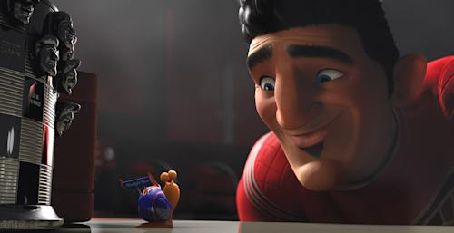 """This film publicity image released by DreamWorks Animation shows Turbo, voiced by Ryan Reynolds, left, Guy Gagné, voiced by Bill Hader, in a scene from the animated movie """"Turbo."""" (AP Photo/DreamWorks Animation)"""