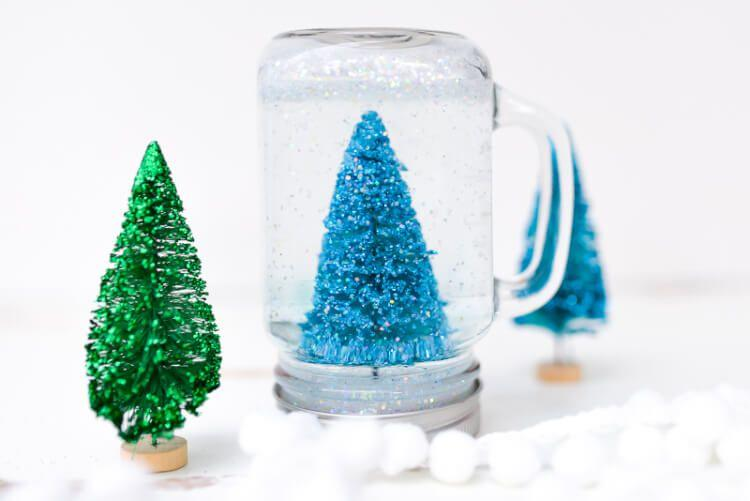 "<p>Make a charming snow globe in a jar using clear Elmer's glue in the water to help the glitter settle more slowly to the bottom for that swirling flurries effect.</p><p><em><a href=""https://heyletsmakestuff.com/jar-snow-globe/"" target=""_blank"">Get the tutorial at Hey Let's Make Stuff»</a></em></p><p><strong>RELATED:</strong> <a href=""https://www.goodhousekeeping.com/home/craft-ideas/g29569319/diy-snow-globes/"" target=""_blank"">15 DIY Snow Globes That Are Completely Charming (and Totally Doable!)</a></p>"