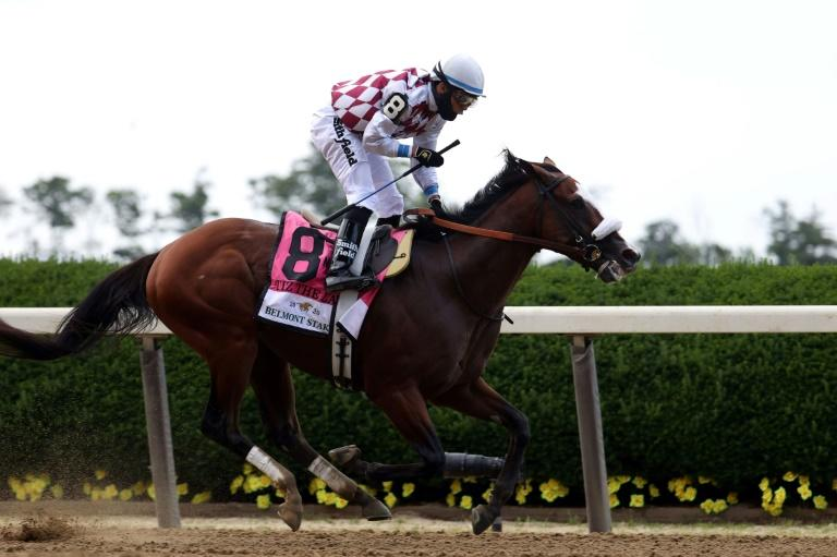 Tiz the Law, ridden by Manny Franco, crosses the finish line to win the 152nd Belmont Stakes