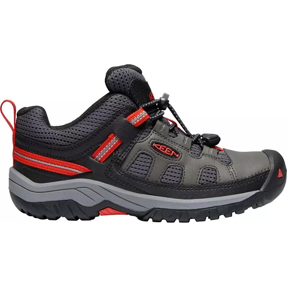 """<p><strong>Keen</strong></p><p>dickssportinggoods.com</p><p><strong>$54.99</strong></p><p><a href=""""https://go.redirectingat.com?id=74968X1596630&url=https%3A%2F%2Fwww.dickssportinggoods.com%2Fp%2Fkeen-kids-targhee-low-hiking-shoes-19keeychtrghlwmgnfbo%2F19keeychtrghlwmgnfbo&sref=https%3A%2F%2Fwww.bestproducts.com%2Fparenting%2Fg32894824%2Fdurable-kids-hiking-boots%2F"""" target=""""_blank"""">Shop Now</a></p><p>Your little adventurer will conquer the trails with these low-cut hiking boots by Keen. Designed to be durable and able to withstand your kids running and jumping, your tot's feet will feel secure and supported. </p><p><strong>More:</strong> <a href=""""//www.bestproducts.com/parenting/g32631135/hiking-baby-carriers/"""" target=""""_blank"""">These Hiking Baby Carriers Will Basically Replace Your Stroller</a></p>"""