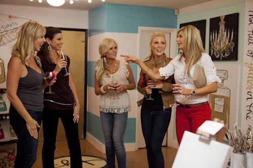 "This undated publicity photo provided by Bravo shows, from left, Vicki Gunvalson, Heather Dubrow, Tamra Barney, Gretchen Rossi and Alexis Bellino in a scene from ""Painting Party"" in Bravo's Season Seven of ""The Real Housewives of Orange County."" Later in 2013, ""The Real Housewives of Orange County"" will reach a TV milestone: its 100th episode. (AP Photo/Bravo, Isabella Vosmikova)"