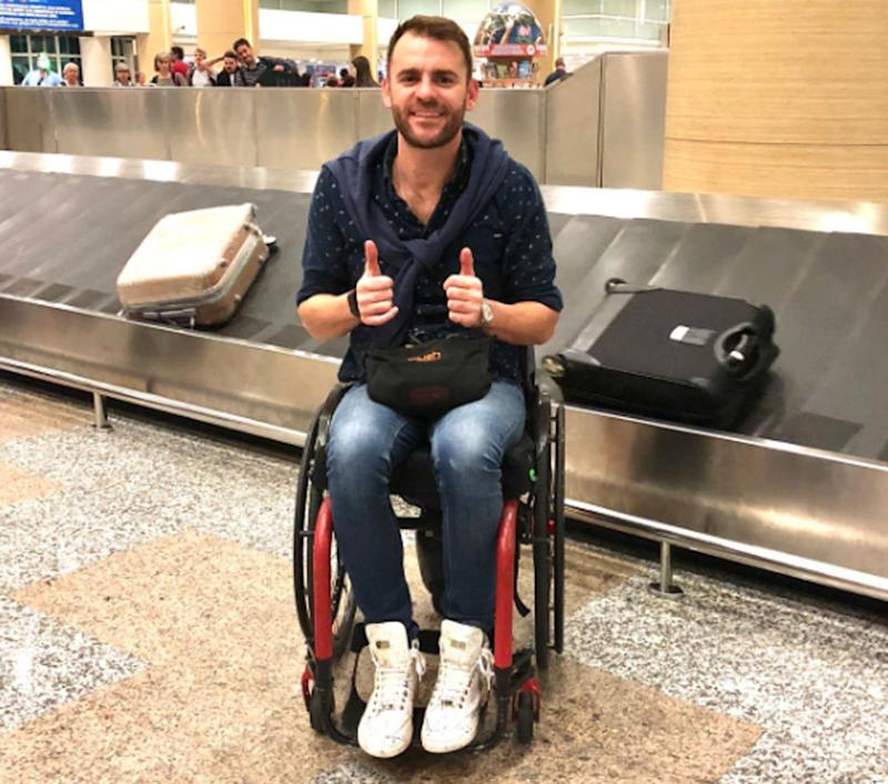 Shane Hryhorec claims he was kicked off a Qantas flight when he wasn't allowed to put his wheelchair in the overhead luggage compartment on a flight from Melbourne to Bali. Source: Twitter/ Shane Hryhorec