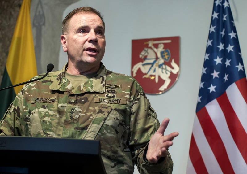 FILE - In this Wednesday, March 1, 2017 file photo then Commander of U.S. Army Europe Lt. Gen. Ben Hodges speaks during a news conference following a meeting with Lithuanian Minister of National Defense Raimundas Karoblis in Vilnius, Lithuania. After more than a year of thinly veiled threats that the United States could start pulling troops out of Germany unless the country increases its defense spending to NATO standards, President Donald Trump appears to be going ahead with the hardball approach with a plan to reduce the American military presence in the country by more than percent. (AP Photo/Mindaugas Kulbis, file)