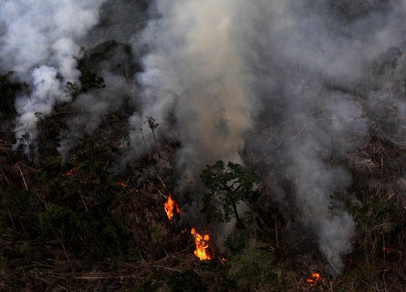 FILE PHOTO: An aerial view of a tract of Amazon jungle burning as it is cleared by farmers in Itaituba