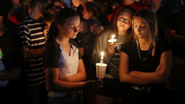 PHOTO: People attend a candle light memorial service for the victims of the shooting at Marjory Stoneman Douglas High School that killed 17 people, Feb. 15, 2018 in Parkland, Fla. (Joe Raedle/Getty Images)
