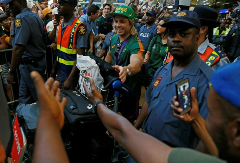 Springboks scrum-half Faf de Klerk is greeted by thousands of supporters at OR Tambo airport near Johannesburg