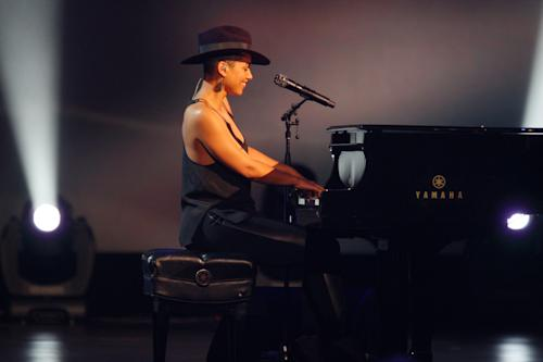 Alicia Keys performs at the night that changed America: a Grammy salute to the Beatles, on Monday, Jan. 27, 2014, in Los Angeles. (Photo by Zach Cordner/Invision/AP)