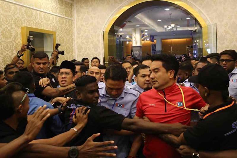 PKR Youth security personnel dressed in black were seen clashing with Mizan and others who attempted to force their way inside the Classic Ballroom of Melaka International Trade Center in Ayer Keroh. ― Picture by Yusof Mat Isa
