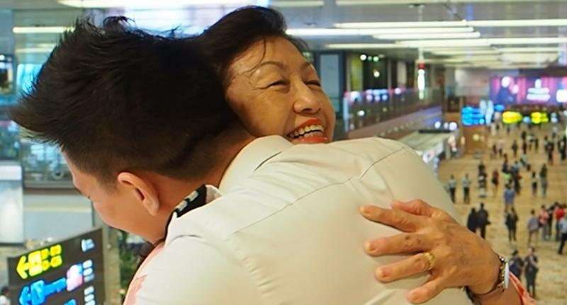 Pilot, Raphael Leong (right) and his mother, Rosalind Leong (left) embracing at the airport