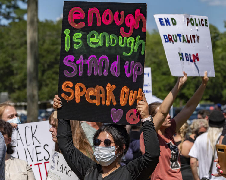 In a Saturday, June 6, 2020 photo, several hundred people came out to Vidor's Gould Park for a protest and peace march in honor of George Floyd, who died while being detained by Minneapolis police. (Fran Ruchalski/The Beaumont Enterprise via AP)