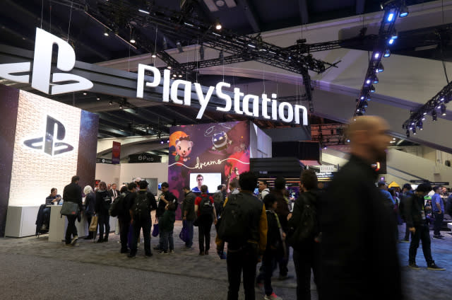 SAN FRANCISCO, CALIFORNIA - MARCH 20: Attendees walk by the Sony PlayStation booth at the 2019 GDC Game Developers Conference on March 20, 2019 in San Francisco, California. The GDC runs through March 22. (Photo by Justin Sullivan/Getty Images)