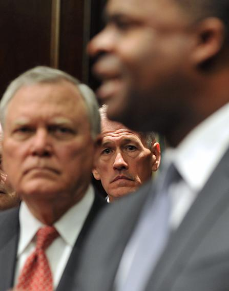Georgia Emergency Management Director Charley English, center, and Gov. Nathan Deal, left, listen to Atlanta Mayor Kasim Reed speak to reporters during a press conference Monday Feb. 10, 2014. Deal issued a state of emergency Monday morning in advance of winter weather that is forecasted for the area. (AP Photo/Atlanta Journal-Constitution, Brant Sanderlin) MARIETTA DAILY OUT; GWINNETT DAILY POST OUT; LOCAL TV OUT; WXIA-TV OUT; WGCL-TV OUT