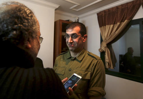 """In this Sunday, Jan. 26, 2014 photo, director Majed Jundiyeh, left, talks to Mahmoud Karira who will play the character of Gilad Shalit in a movie being made in Gaza called, ''Losing Shalit,"""" in Gaza City. """"Losing Schalit,"""" currently being filmed in the blockaded territory, is the first of a planned three-part series about the 2006 capture of Israeli soldier Gilad Schalit by gunmen allied with the Islamic militant Hamas movement. Parts two and three will depict Schalit's time in captivity and his 2011 swap for hundreds of Palestinian prisoners held by Israel. (AP Photo/Hatem Moussa)"""