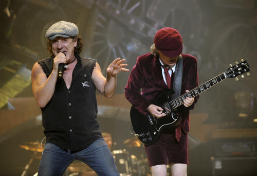 """FILE - In this Nov. 12, 2008 file photo, AC/DC lead singer Brian Johnson, left, and Angus Young perform on the Black Ice tour at Madison Square Garden in New York. Columbia Records and Apple announced Monday, Nov. 19, 2012, that the classic rock band's music will be available at the iTunes Store worldwide. Sixteen albums will be released, including """"High Voltage"""" and """"Back in Black."""" (AP Photo/Jeff Zelevansky, file)"""