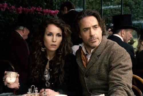 "In this film image released by Warner Bros. Pictures, Noomi Rapace, left, and Robert Downey Jr. are shown in a scene from ""Sherlock Holmes: A Game of Shadows."" Two and a half years after the debut of ""Dragon Tattoo,"" the first of her three eye-popping turns as late author Stieg Larsson's untamed heroine, Rapace has stormed into Hollywood in Robert Downey Jr.'s latest Sherlock Holmes adventure. (AP Photo/Warner Bros. Pictures)"