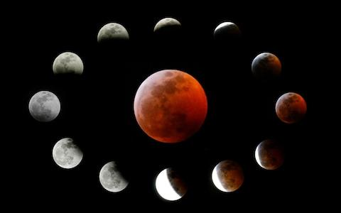 This combination photo shows the totally eclipsed moon, centre, and others at the different stages during a total lunar eclipse, as seen from Los Angeles, Sunday, Jan. 20, 2019