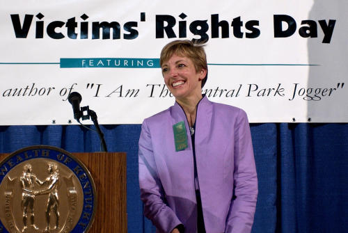 FILE - In this April 14, 2005 file photo, Trisha Meili acknowledges the applause in Frankfort, Ky., after delivering a speech at a Crime Victims' Rights Day ceremony. Five teenage boys maintained their innocence as they grew up behind bars after being convicted in 1990 of the rape and brutal beating of Meili, who came to be known as the Central Park jogger. The convictions of the five were eventually tossed out by a judge when new evidence surfaced linking someone else to the crime. But their legal battle goes on: A $250 million federal lawsuit against police and prosecutors has been pending nearly a decade, with no resolution in sight. (AP Photo/Ed Reinke, File)