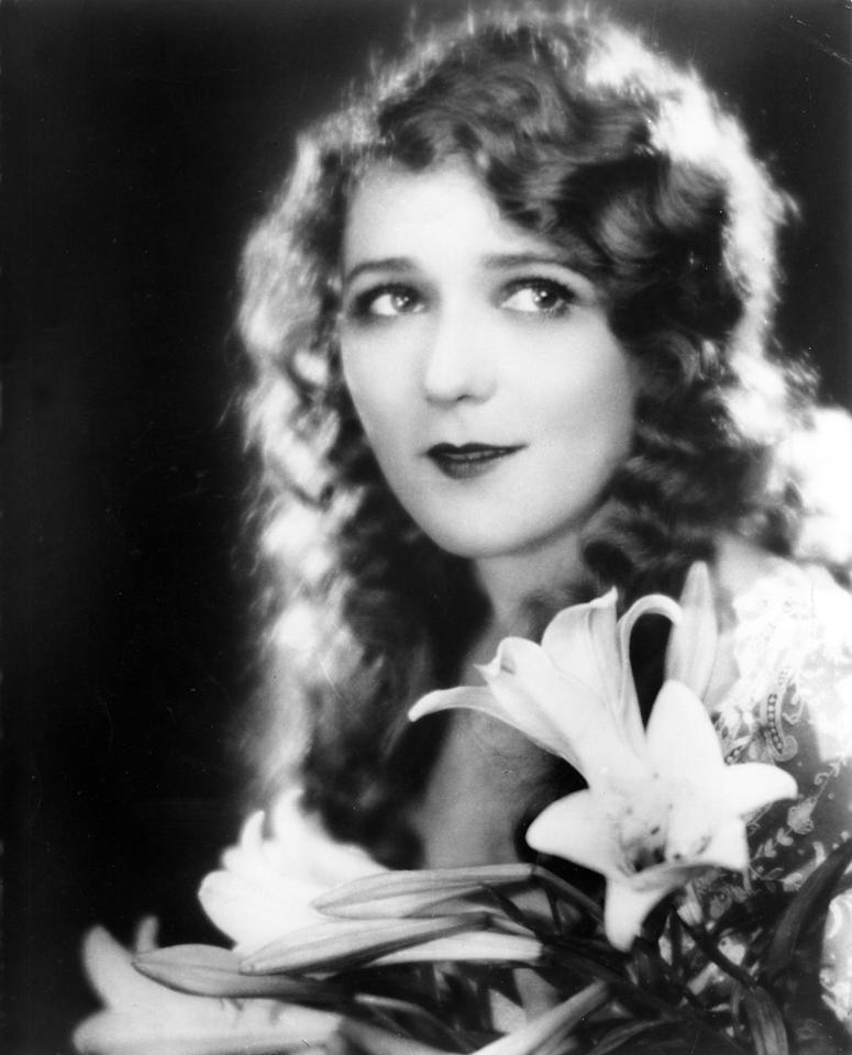 <p>As soft and ethereal as the early films this style was worn for, brushed-out waves gave actresses like Mary Pickford a feminine silhouette.</p>