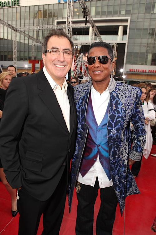 "FILE - In this Oct. 27, 2009 file photo, Director/Producer Kenny Ortega and Jermaine Jackson attend the Columbia Pictures' Premiere of Michael Jackson's ""This Is It"" at the Nokia Theatre L.A. Live, in Los Angeles. Jurors hearing a case filed by Katherine Jackson over her son Michael's death have received a behind-the-scenes look at the superstar's troubles off-camera as he prepared for his ill-fated comeback shows. The panel was reminded on Thursday, Aug. 8, 2013, of statements describing the ""Thriller"" singer as deteriorating and slow to pick up material for the shows that would heavily feature the hits that made him famous, but defense attorneys for concert promoter AEG Live LLC say the ""This Is It"" footage is an accurate portrayal of his preparations and doesn't show Jackson in decline. (Photo by Eric Charbonneau/Invision/AP Images, File)"