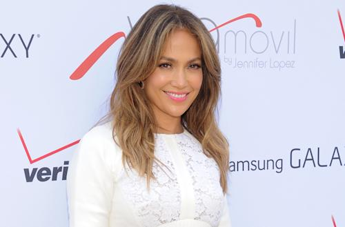 "FILE - This July 26, 2013 file photo shows singer and actress Jennifer Lopez at the ""Viva Movil by Jennifer Lopez"" flagship store grand opening in the Brooklyn borough of New York. Lopez, the 44-year-old mother of 5-year-old twins, Maximilian and Emme, will receive the Grace Kelly Award at the March of Dimes luncheon at the Beverly Hills Hotel on Friday, Dec. 6, 2013. She's being recognized as a celebrity parent role model supporting women giving birth to healthy babies after full-term pregnancies.(Photo by Evan Agostini/Invision/AP, File)"