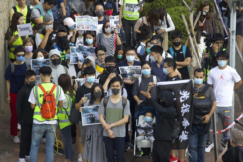 Parents and children gather during a rally to protest against the exposure of children to tear gas by police in Hong Kong, Saturday, Nov. 23, 2019. President Donald Trump on Friday wouldn't commit to signing bipartisan legislation supporting pro-democracy activists in Hong Kong as he tries to work out a trade deal with China. (AP Photo/Ng Han Guan)