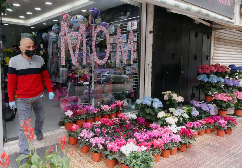 Florist displays flowers for customers outside his shop as flower shops are open exceptionally for Mother's Day, in Beirut