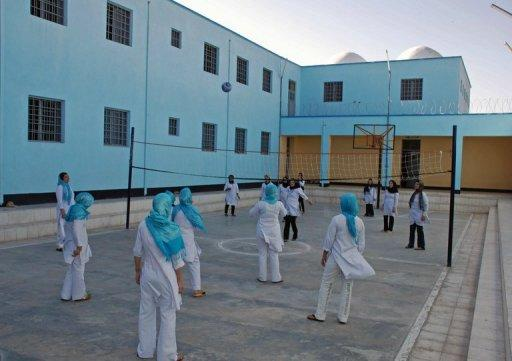 <p>File photo for illustrative purposes showing female Afghan prisoners playing volleyball in a prison. A woman who has served two years in jail after a relative raped her at her home is to be released after 5,000 people signed a petition in support of her case.</p>