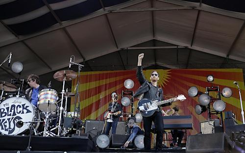 The Black Keys perform at the New Orleans Jazz and Heritage Festival in New Orleans, Sunday, May 5, 2013. (AP Photo/Gerald Herbert)
