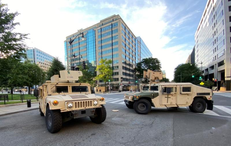 U.S. military humvees block street near White House as the number of U.S. military forces deployed to the streets of the nation's capital increases in Washington