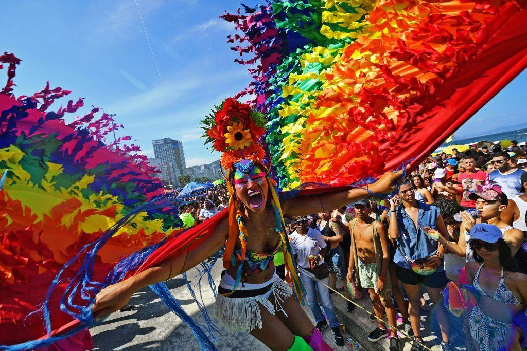 """<p>People should always be proud of who they are, but that rings extra true for members of the LGBTQ+ community during June. Every year at this time, which is also know as <a href=""""https://www.womansday.com/life/a32894238/what-is-pride/"""" target=""""_blank"""">Pride Month</a>, people around the world gather to celebrate the strides for equality that the LGBTQ+ community has made. It's also a good time to remember the history of LGBTQ+ people and the challenges they have faced. This often ends in over-the-top parades that celebrate what it means to be LGBTQ+. But it wasn't always like as, as evident from Pride photos throughout the years. </p><p>The first Pride event, which took place in 1949 was known as the <a href=""""https://www.history.com/news/stonewall-riots-timeline"""" target=""""_blank"""">Stonewall Rebellion.</a> This event was a series of resistance that helped propel the LGBTQ+ equality movement into a global platform. Since then, Pride events have evolved, but the message remains the same: love is love, and should be equal for all.  </p>"""