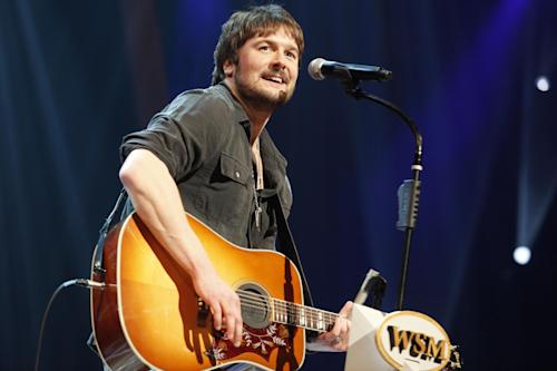 FILE - In this March 18, 2011 file photo, country singer Eric Church performs at the Grand Ole Opry in Nashville, Tenn. Brad Paisley and Carrie Underwood co-host the CMA awards show on Thursday, Nov. 1, 2012, at 8 p.m. EDT, live on ABC from the Bridgestone Arena in Nashville. From Taylor Swift's army of empowered young women to the power-drinking party boys who prefer Church and Jason Aldean, country's audience is much different than it was 10 years ago and that's reflected in the awards. (AP Photo/Ed Rode, File)