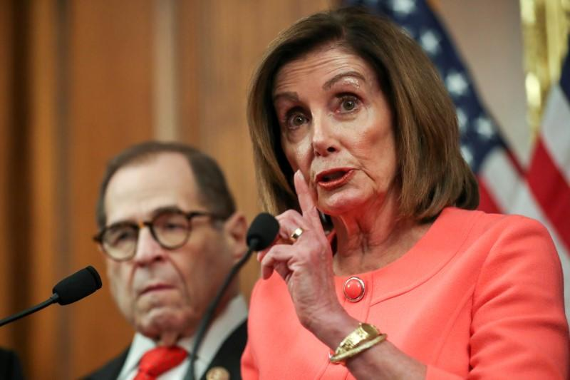 U.S. House Speaker Pelosi holds engrossment ceremony to sign Trump impeachment articles at the U.S. Capitol in Washington