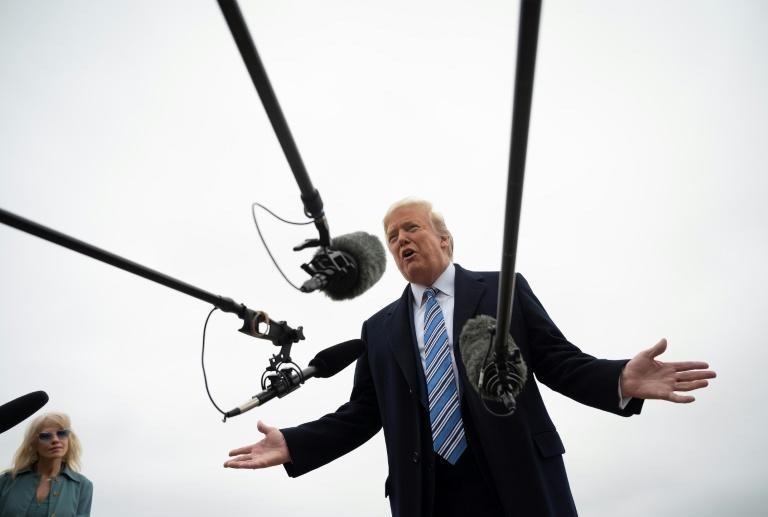 US President Donald Trump speaks to the press before boarding Air Force One at Joint Base Andrews in Maryland, on March 28, 2020 en route to Norfolk, Virginia