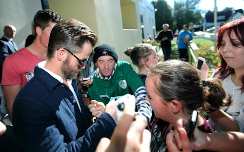 """Hollywood actor Chris Pine, left, is surrounded by people outside a courthouse in Ashburton, New Zealand, Monday, March 17, 2014. Pine, known for playing Captain Kirk in the """"Star Trek"""" movies, pleaded guilty in the New Zealand court to drunken-driving charges. The 33-year-old was fined $93 New Zealand dollars ($79) and had his New Zealand driver's license suspended for six months during a hearing at the Ashburton District Court. (AP Photo/Ashburton Guardian, Tetsuro Mitomo) NEW ZEALAND OUT, AUSTRALIA OUT, NO SALES"""