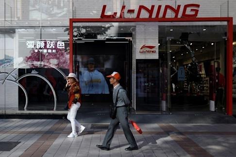People walk past a Li-Ning store in Beijing on October 2019. Photo: AFP