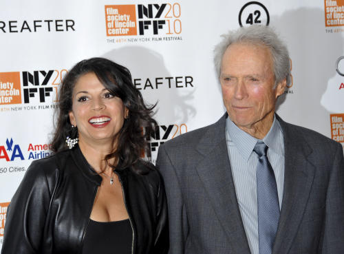 "FILE - In this Oct. 10, 2010 file photo, director and producer Clint Eastwood, right, and wife Dina Eastwood attend the premiere of ""Hereafter"" at Alice Tully Hall during the 48th New York Film Festival, in New York. Dina Eastwood filed for divorce after 17 years of marriage from her husband on Oct. 22, 2013, in Monterey, Calif., citing irreconcilable differences. (AP Photo/Evan Agostini, File)"