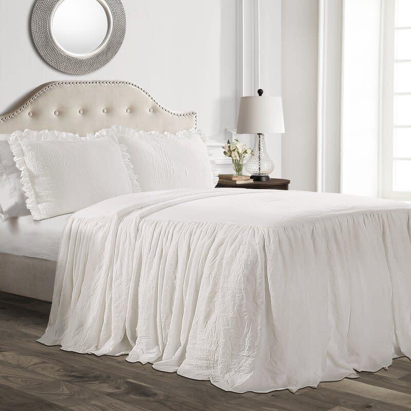 Lewis Ruffle Skirt Bedspread Set. Image via Wayfair.