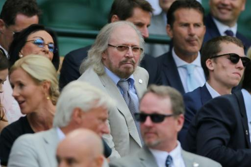 Friday afternoon fever: British singer Barry Gibb takes his seat in the Royal box on Centre Court