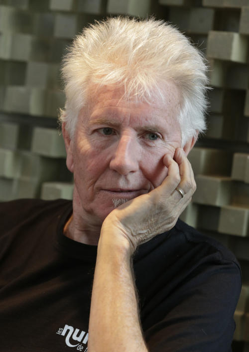 """Singer Graham Nash is interviewed during a break in the recording session for the audio book version of his """"Wild Tales: A Rock & Roll Life"""" autobiography, in New York, Thursday, July 25, 2013. (AP Photo/Richard Drew)"""